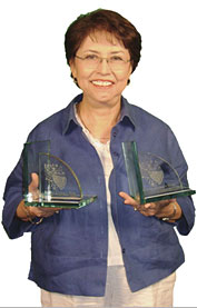 Connie Reza with her Awards